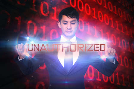 unauthorized: The word unauthorized and unsmiling businessman holding against glowing swirl on black background LANG_EVOIMAGES