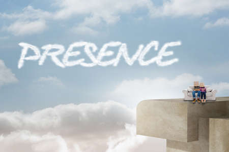 presence: The word presence and silly employees with arms folded wearing boxes on their heads against balcony and bright sky