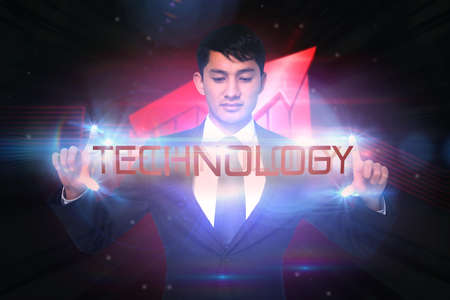 unsmiling: The word technology and unsmiling businessman holding against glowing swirl on black background LANG_EVOIMAGES