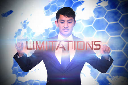 limitations: The word limitations and unsmiling businessman holding against glowing swirl on black background