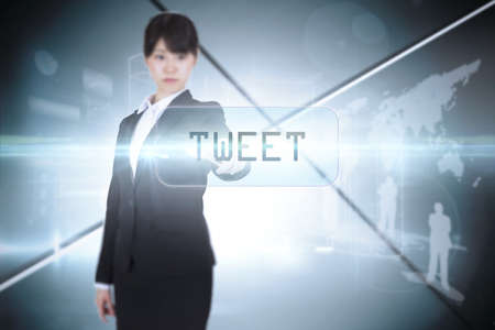 tweet: The word tweet and focused businesswoman pointing against futuristic screen with lines