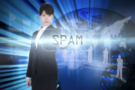 unsolicited: The word spam and focused businesswoman pointing against digital earth background