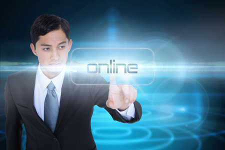unsmiling: The word online and unsmiling asian businessman pointing against futuristic shiny black background