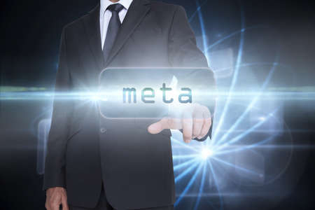 meta: The word meta and businessman pointing against shiny sphere on black background LANG_EVOIMAGES