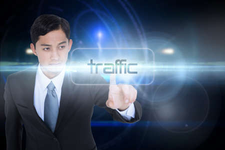unsmiling: The word traffic and unsmiling asian businessman pointing against futuristic black background with circles