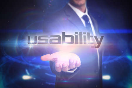 usability: The word usability and businessman presenting against futuristic black background with circles