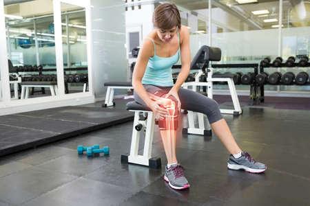 digital composite: Digital composite of Highlighted bones of injured woman at gym LANG_EVOIMAGES