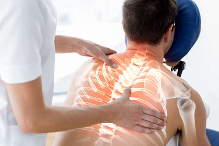 digital composite: Digital composite of Highlighted spine of man at physiotherapy