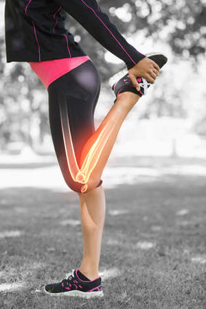 body concern: Digital composite of Highlighted leg of stretching woman LANG_EVOIMAGES