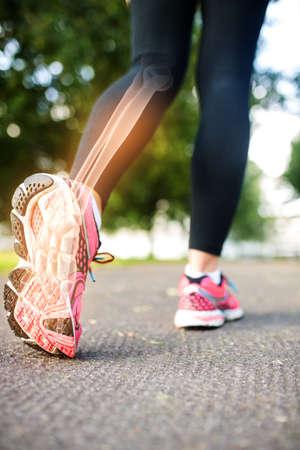 digital composite: Digital composite of Highlighted foot bones of jogging woman