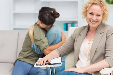 difficulties: Psychologist helping a couple with relationship difficulties in the office