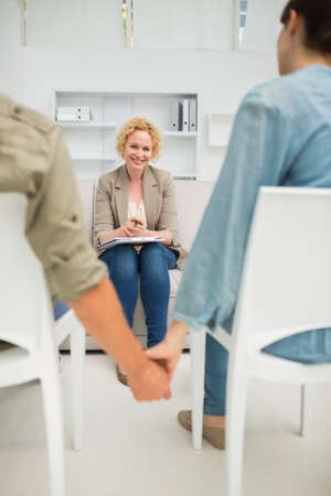 relationship difficulties: Psychologist helping a couple with relationship difficulties in the office