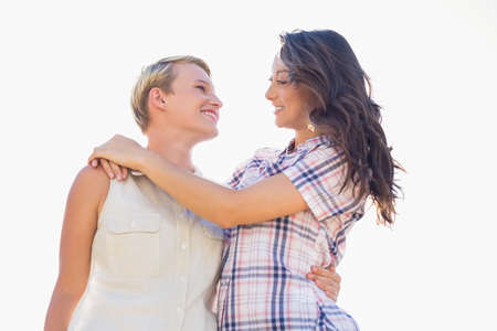 homosexual partners: Lesbian couple looking at each other with arms around LANG_EVOIMAGES