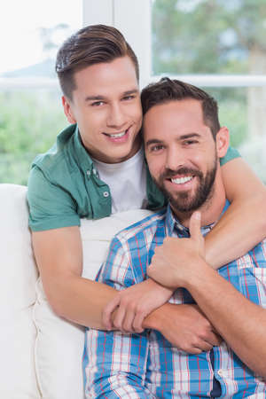 homosexual: Portrait of smiling homosexual couple men hugging each other LANG_EVOIMAGES