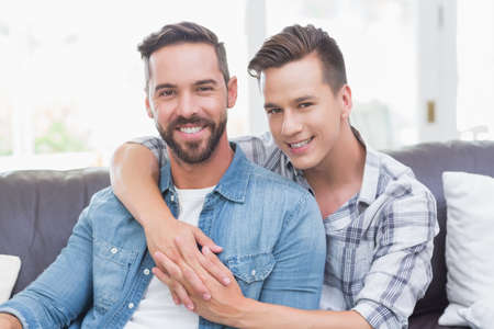 arms around: Portrait of homosexual couple men with arms around