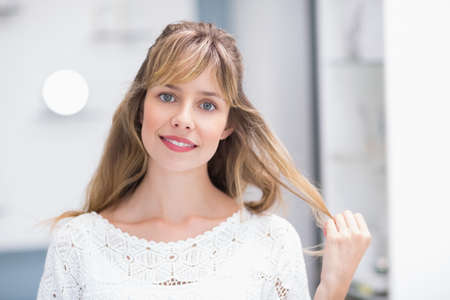 beauty store: Portrait of a beautiful smiling costumer in a beauty store