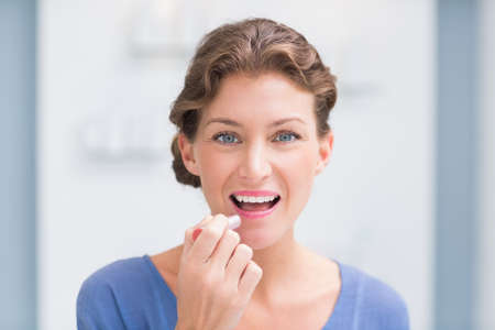 beauty store: Beautiful costumer putting on makeup in a beauty store