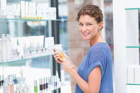 costumer: Beautiful costumer looking at product in a beauty store