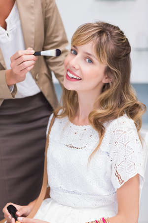 beauty store: Beautiful woman getting makeup applied in a beauty store LANG_EVOIMAGES