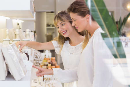 beauty store: Beautiful women looking at products in a beauty store