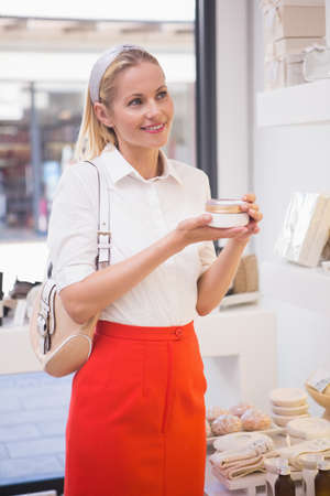 moisturiser: Pretty blonde shopping for beauty products in the pharmacy