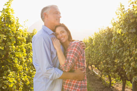 int: Portrait of smiling woman embracing her man int the grape fields