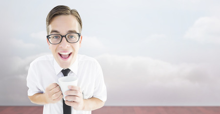 cheesy grin: Geeky businessman holding a mug against clouds in a room
