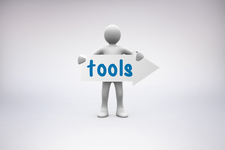human representation: The word tools and human representation holding arrow sign against grey background
