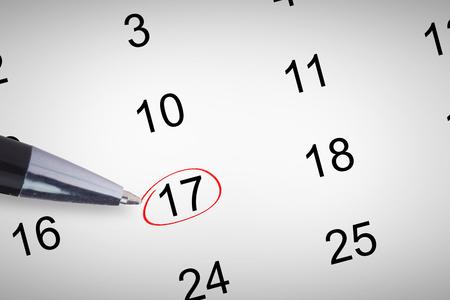 western script: Pen  against december month on calendar Stock Photo