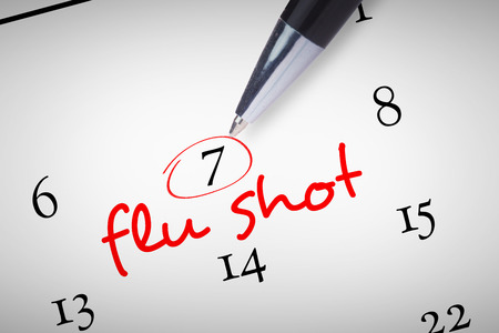 flu shots: Pen  against flu shots Stock Photo