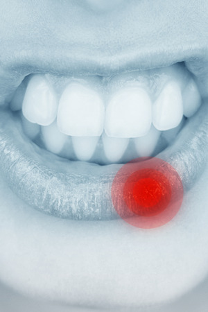 growling: Close up of female mouth growling against highlighted pain Stock Photo