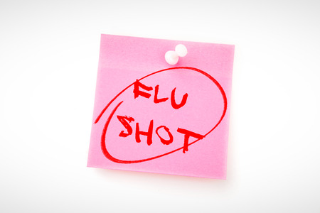 flu shots: flu shots against pink adhesive note with pushpin