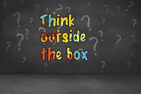 unsure: think outside the box against white question marks on grey wall Stock Photo