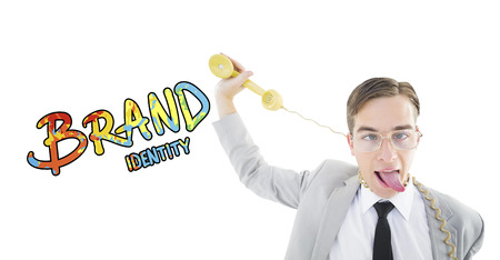 phone cord: Geeky businessman being strangled by phone cord against brand identity Stock Photo