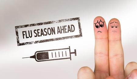 Sad fingers against flu shot message Stock Photo