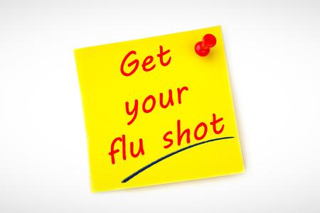 gripe: obtener su vacuna contra la gripe en contra amarillo nota adhesiva clavado