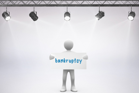 credit crunch: The word bankruptcy and spotlights against grey background