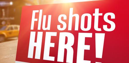 flu shots: flu shots here against blurry new york street Stock Photo