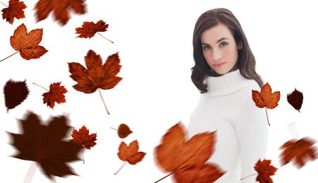 jumper: Pretty brunette in white jumper posing against autumn leaves