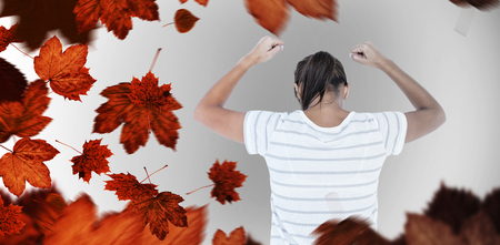 apprehensive: Depressed woman with hands raised against autumn leaves Stock Photo