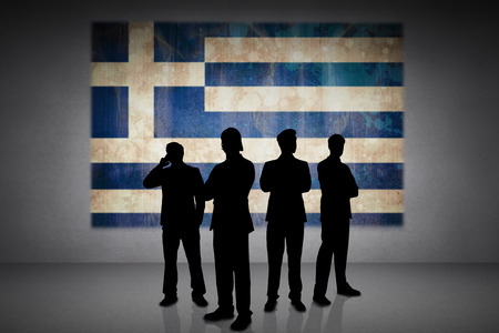 incidental people: Silhouette of businessmen against greece flag in grunge effect