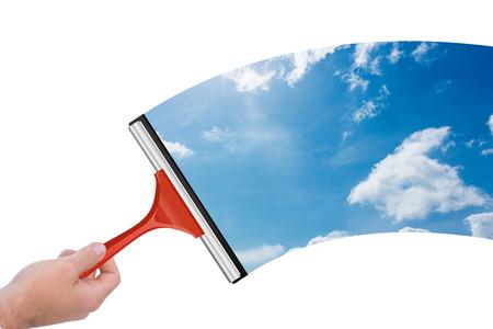 wiper: Hand using wiper against blue sky