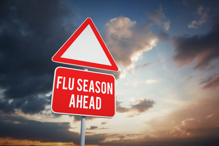 flu vaccines: flu season ahead against blue and orange sky with clouds Stock Photo