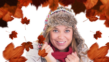 red cardigan: Happy blonde in winter clothes against autumn leaves pattern