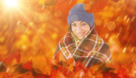 checked: Smiling brunette with checked blanket against park