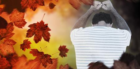 man crying: Upset man leaning on white background against autumn scene
