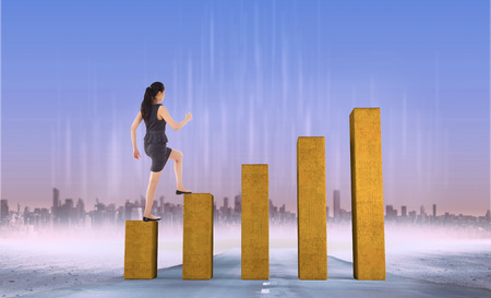 stepping: Businesswoman stepping up against bar chart depicting growth Stock Photo