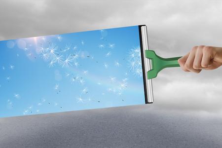 wiper: Hand using wiper against cloudy dull sky