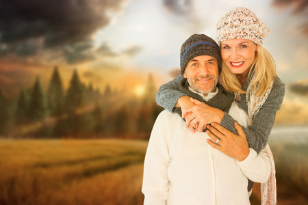 happy wife: Portrait of wife embracing husband against country scene