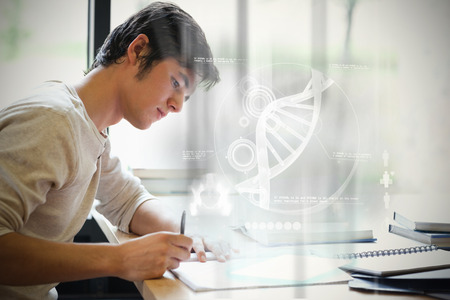 scientific literature: Illustration of DNA against serious male student writing Stock Photo
